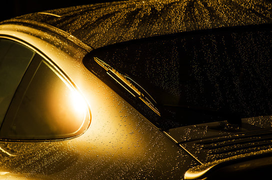 Extreme close up of water droplets on car