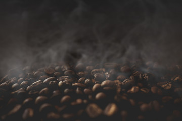 Foto op Canvas koffiebar Close up of coffee beans with smoke