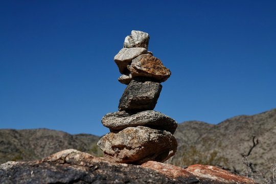 Rocks are piled in a stack known as a ciarn to mark a hikers passage along a trail.