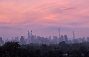 Foto op Aluminium Kuala Lumpur BUILDINGS IN CITY AGAINST SKY DURING SUNSET