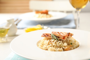 Delicious chicken risotto served on table, closeup