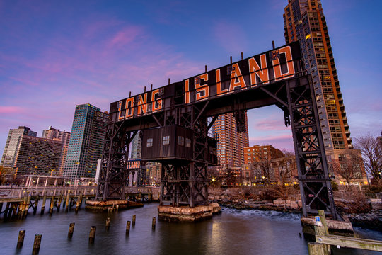 Sunset Pink Sky Over Long Island City Sign at Gantry Plaza State Park in Queens New York