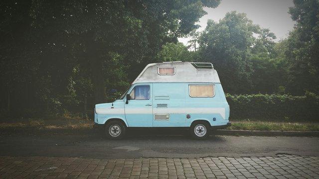 Side View Of A Camper Van On Street