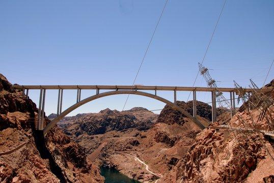 Mike O Callaghan Pat Tillman Memorial Bridge Over River Amidst Rocky Mountains Against Sky