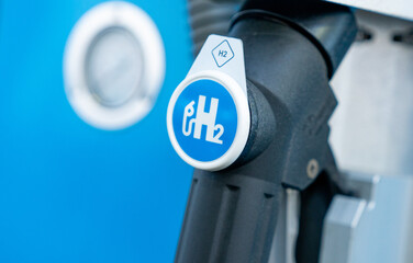 hydrogen logo on gas station. h2 combustion engine for emission free ecofriendly transport.