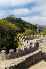 Scenic view of the medieval hilltop castle Castelo dos Mouros (The Castle of the Moors) in Sintra, Portugal.