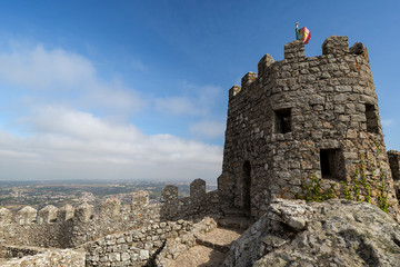 Scenic view of the medieval hilltop castle Castelo dos Mouros (The Castle of the Moors) and surrounding area below in Sintra, Portugal.