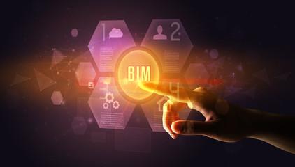 Hand touching BIM inscription, new technology concept Wall mural
