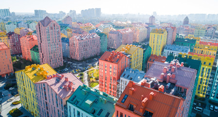 Printed roller blinds Kiev Urban landscape of colorful buildings. Aerial view of the colorful buildings in the European city in the morning sunlight. Cityscape with multicolored houses, cars on the street in Kiev, Ukraine.