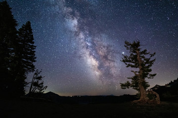 Milky Way galaxy and starry night sky over Crater Lake National Park, Oregon