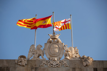 Flags of Spain flying on top of building