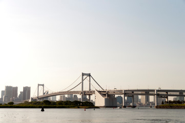 Foto op Plexiglas Stadion Rainbow Bridge Over Tokyo Bay In City Against Clear Sky