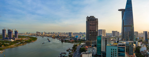 Ho Chi Minh City, Vietnam - CIRCA Jan 2020: Aerial cityscape of Ho Chi Minh City at sunset. The left part of Saigon River is District 2, and the right part is District 1.