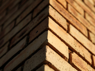 Low Angle View Of Brick Wall During Sunny Day