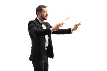 Male conductor in a suit conducting with a baton and gesturing with hand