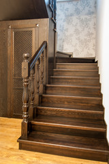 A hardwood staircase and stairwell storage