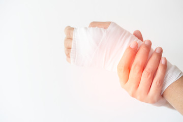 Women with painful wrist due to overuse or sport accidental on white background, Hand of girl...