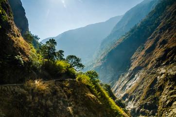 Wall Murals Deep brown Marshyangdi river valley in the soft morning light. Annapurna circuit trek, Nepal.