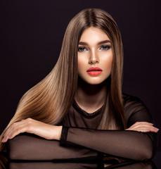 Papiers peints Salon de coiffure Woman with beauty long brown hair. Beauty woman with living coral color lipstick on lips.
