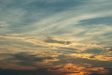 sunlight through cloud on dramatic sunset sky