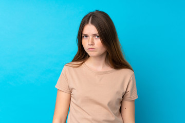 Ukrainian teenager girl over isolated blue background with sad and depressed expression