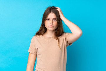 Ukrainian teenager girl over isolated blue background with an expression of frustration and not...