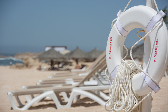 Ropes On White Lifebelt At Beach Against Clear Sky