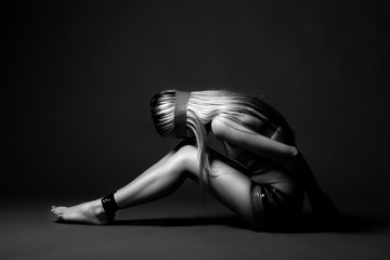 Side views of sad desperately young tied woman