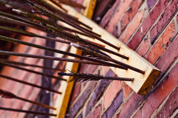Incense Sticks On Wooden Plank Mounted On Brick Wall