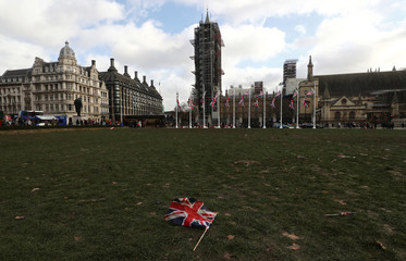 Union Jack flag lays on the ground at Parliament Square in London