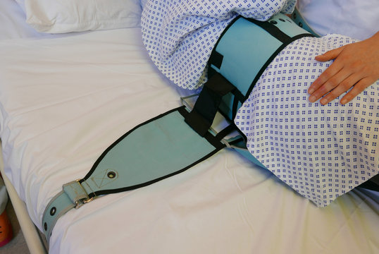 Cropped Person Lying In Hospital Bed