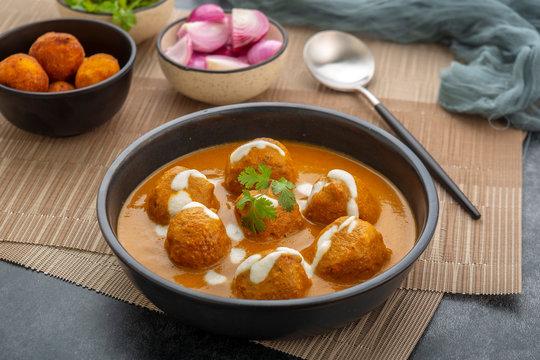 Cheese ball dipped in creamy gravy or Malai Kofta