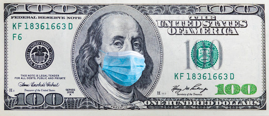 100 dollar banknote with medical mask. The concept of coronavrius epidemic