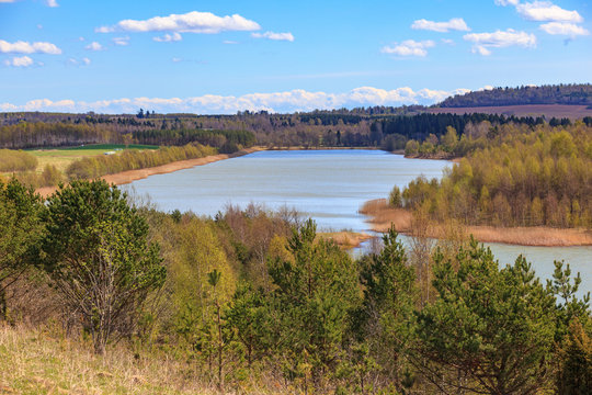 Filled open pit lake in a beautiful spring landscape