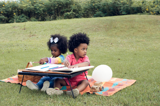 Little african boy and girl playing in backyard