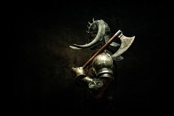 Portrait of a Viking Berserker warrior, holding an ax on his shoulder
