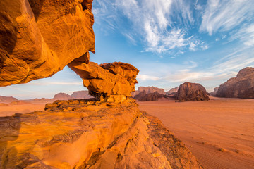 Little bridge rock formation illuminated by sunrise, Wadi Rum desert, Jordan