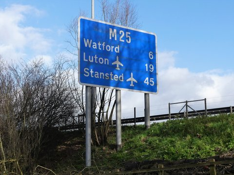 M25 motorway sign at Chorleywood, Hertfordshire showing distances to Watford, Luton Airport and Stanstead Airport