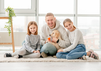 Happy family and puppy