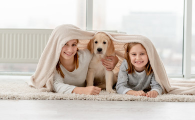Lovely sisters and puppy
