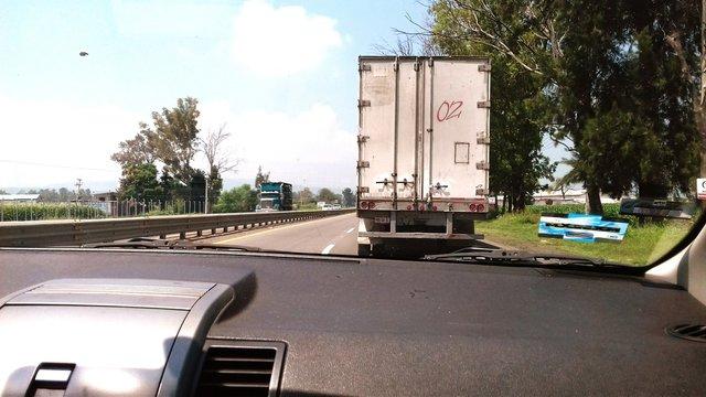 Semi-Truck On Road Seen Through Windshield