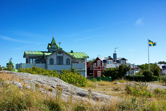 Typical swedish wooden houses on a hill in Sandhamn, Sweden