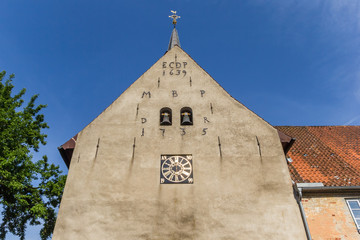Fototapete - Facade of the monastery church in Holm village of Schleswig, Germany