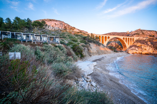 Beach and old railway bridge at Carry le Rouet France