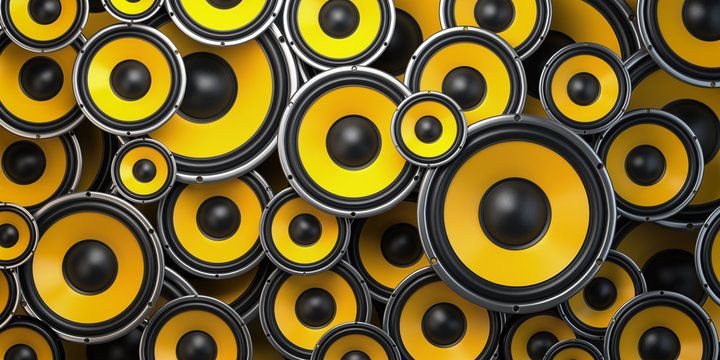 Acoustic sound speakers background. Yellow subwoofers of different size. Multimedia, audio and sound concept.