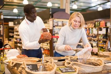 Fotobehang Bakkerij Man and woman buying bulk foods