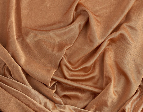 crumpled brown shiny fabric for dress making, lurex