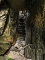 Tourist passage through Szczeliniec sanstone ravine, Table Mountain National Park, Poland
