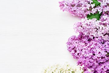 Wall Murals Lilac Spring lilac flowers on white background. Top view, copy space. Holiday concept. Spring background.