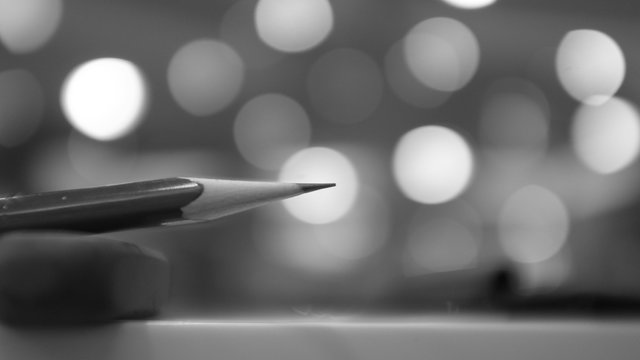 Close-Up Of Pencil On Table Against Lights